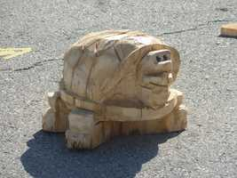 A wood-carved turtle at the lumberjack area.