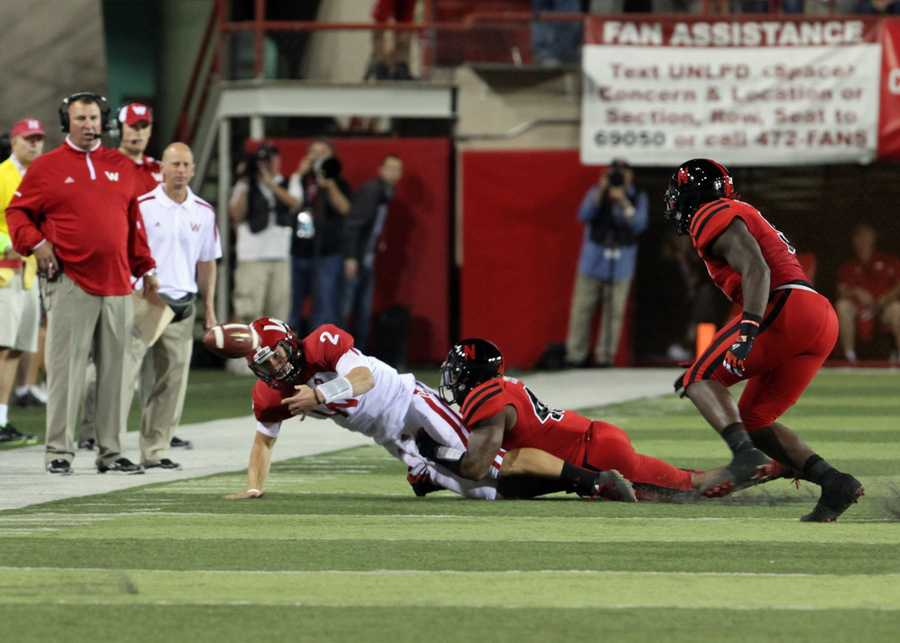 Joel Stave fumbles the ball out of bounds after being sacked for a loss.