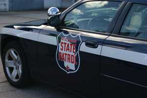 The State Patrol lead the procession from Milwaukee to Green Bay.