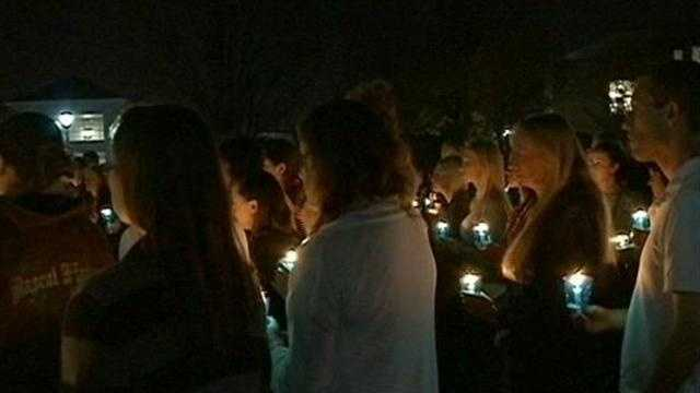 Students, staff and members of the Women's Center hold a vigil at Carrooll University to remember Zina Haughton.