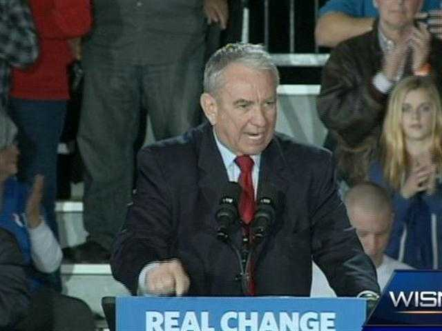 Republican U.S. Senate candidate Tommy Thompson rallies the crowd at the Romney event at State Fair Park on Friday.