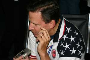 Joe Dean, Chairman of Stars and Stripes Honor Flight, doing a radio interview before the flight.