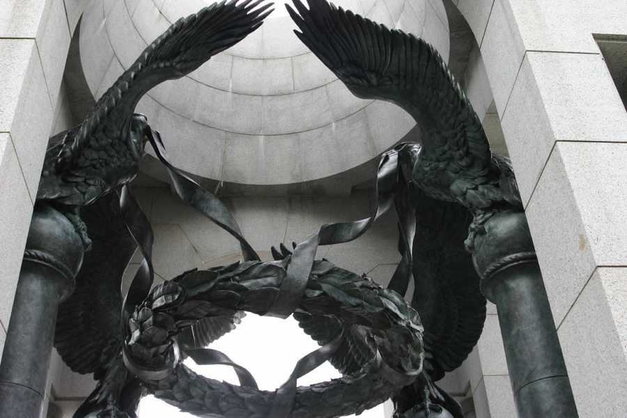 Four bronze eagles hold a 5,000 pound wreath hanging in each of the arches.