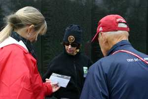 Park rangers are on hand to answer questions or help find names on the wall.