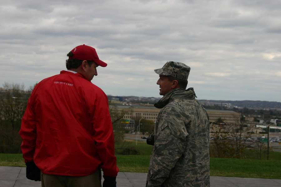 Old friends talking at the Air Force Memorial, overlooking the Pentagon