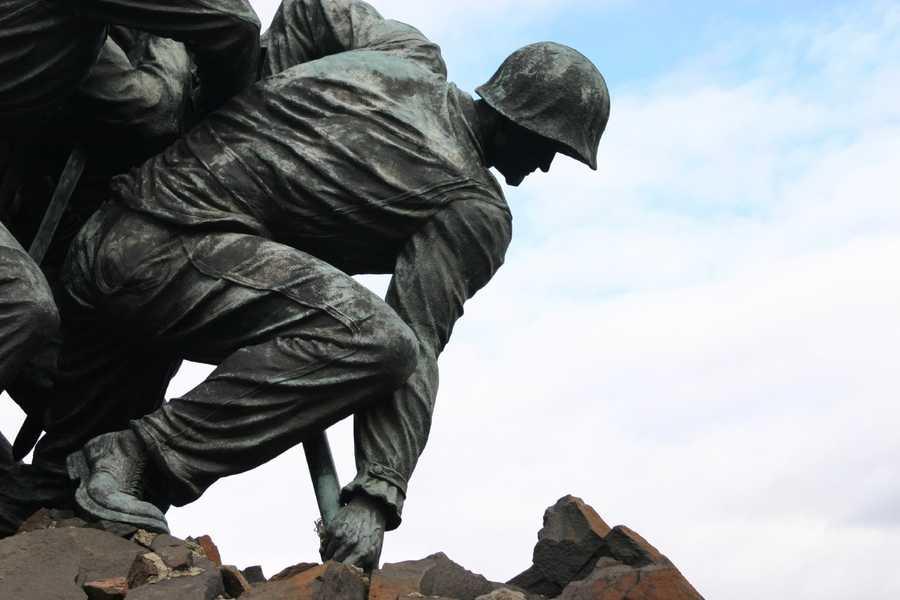 "Felix de Weldon's design was based on the iconic photo ""Raising the Flag on Iwo Jima"" by AP photographer Joe Rosenthal."