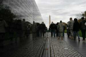 Vietnam Veterans Memorial wit the Washington Monument in the distance.