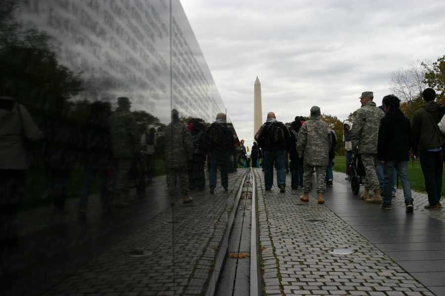 Vietnam Veterans Memorial wit the Washington Monument in the distance.