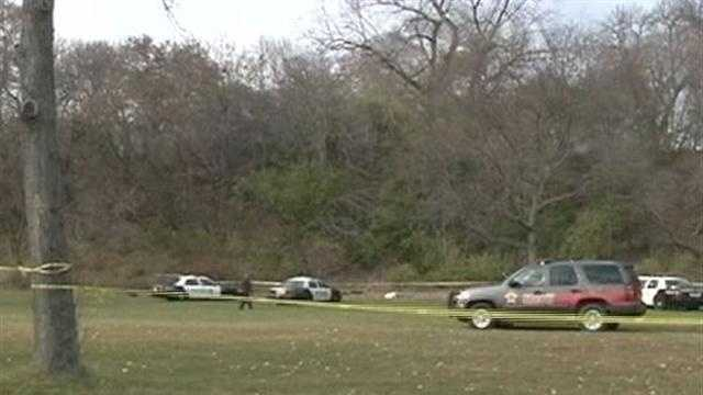 Two children picking up trash near Milwaukee's lakefront find a body in the brush.