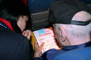 Even the flight attendants were moved to sit and read the letters with the vets.
