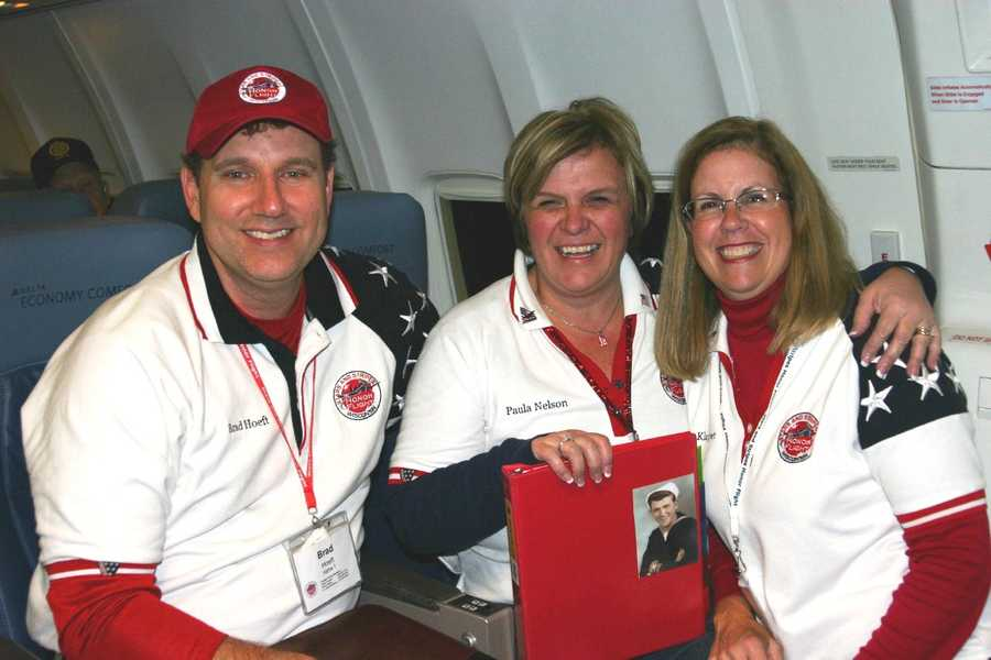 Brad, Paula and Amy- 3 of the Stars and Stripes Honor Flight board members that were on the Alpha Company plane.
