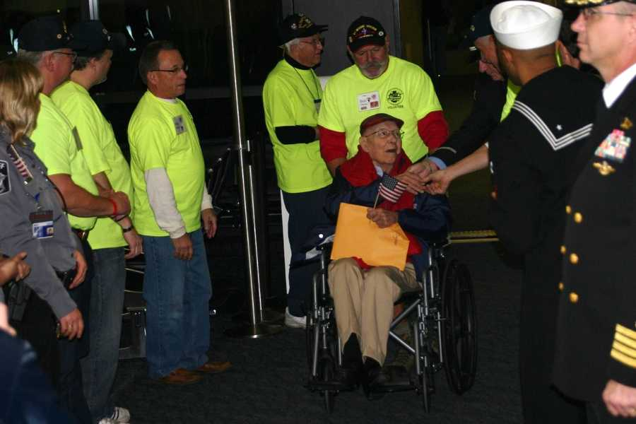 The first vet is off the plane in Milwaukee  and is greeted by volunteers and active duty and reserve personnel.