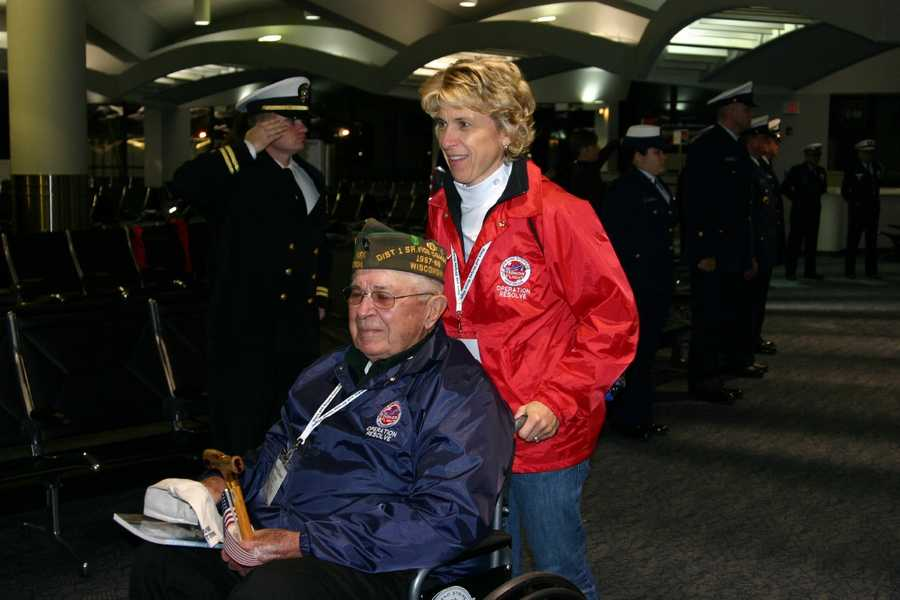 Each veteran is paired with a guardian for the trip. The guardian is sometimes a family member, but other times it is just someone passionate about the cause.