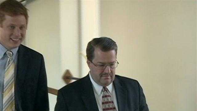 Tim Russell walking into court