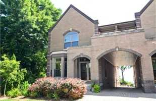 This home is listed at $1,225,000 and has three bedrooms and three baths. The woodwork inside this townhouse is something to see. For more information about this property, click here.