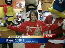 Hillary Mintz was out celebrating 12-12-12 with the Racing Sausages at Dunkin Donuts... and they all approved of her picture-perfect sweater.