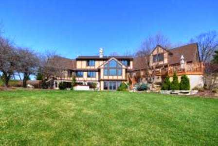 This grand home sits on 49 acres in Menomonee Falls. It has all sorts of riding trails and an indoor riding arena. It's currently listed at just under $2 million. For more information about this property, click here.