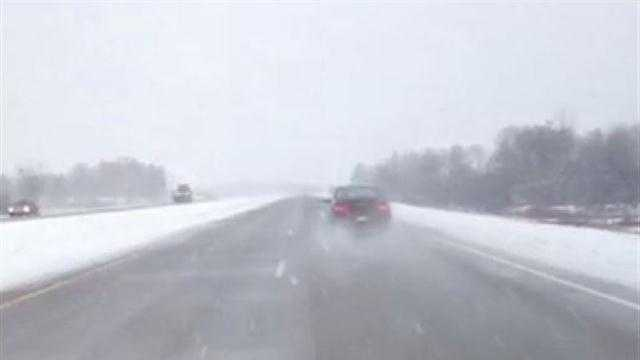 WISN 12 News reporter Nick Bohr finds snow driving west of Oconomowoc.