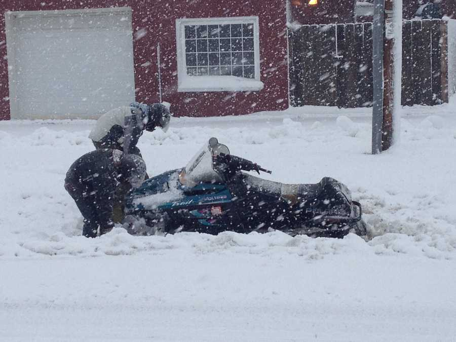 Snowmobilers trying to dig out in Ixonia