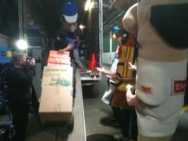 The Racing Sausages lend a hand with packing.