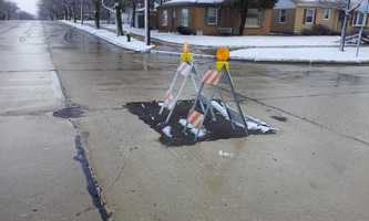 A sinkhole at Graceland Boulevard and Illinois Street in Racine was patched up Wednesday.