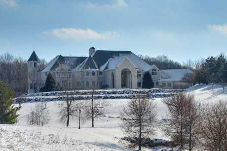 This house has everything, including an observation tower! The six bedrooms and 10 baths within the 19,000 square feet of living space. There's a virtual indoor golf course and a 2,700 bottle wine cellar. For more information on this property,click here.