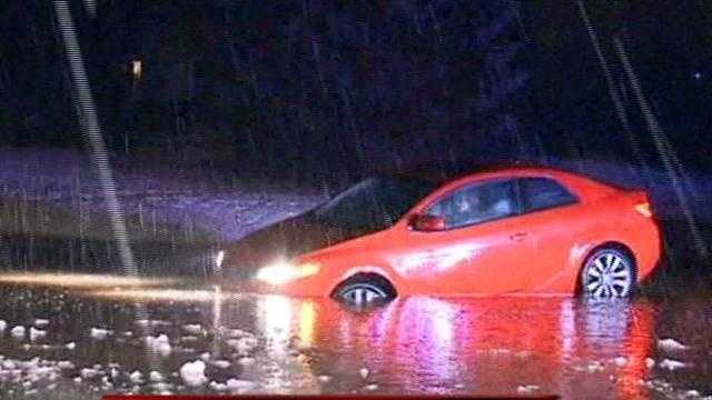 Car stranded on a flooded street in Sussex