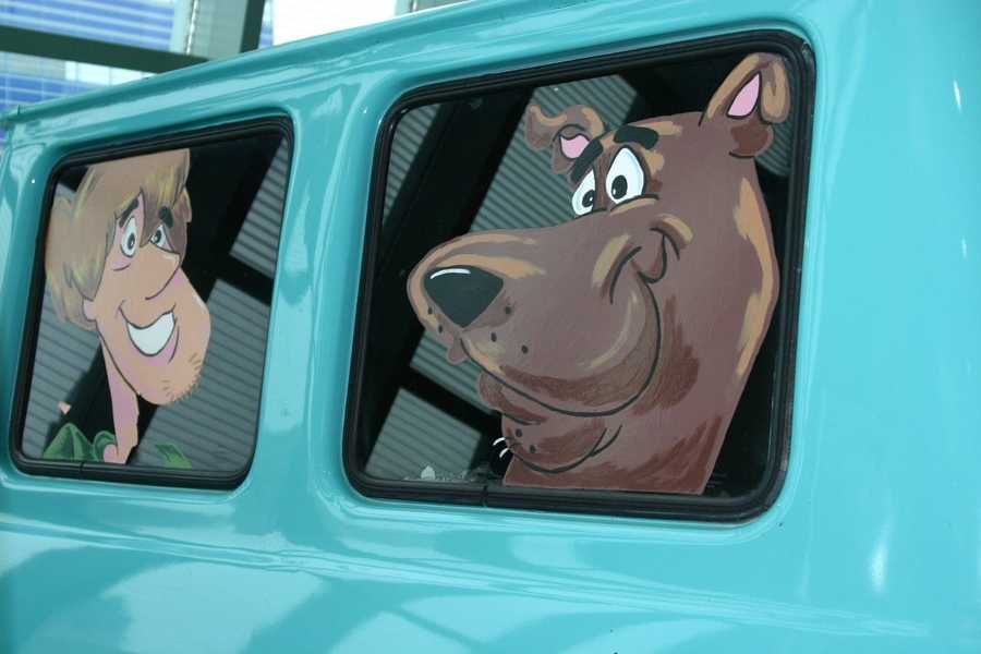 Scooby and Shaggy looking out the back windows.