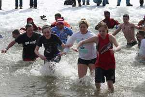 Running out of the water seemed like a better idea until they realized the air temperature was only 26 degrees!