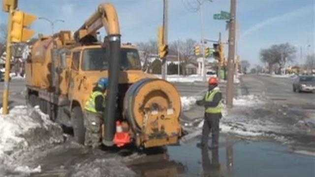Because of flooding concerns, Milwaukee DPW workers are cleaning catch basins.