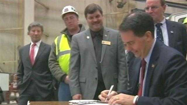 Gov. Scott Walker signed Wisconsin's controversial mining law on March 11, 2013.