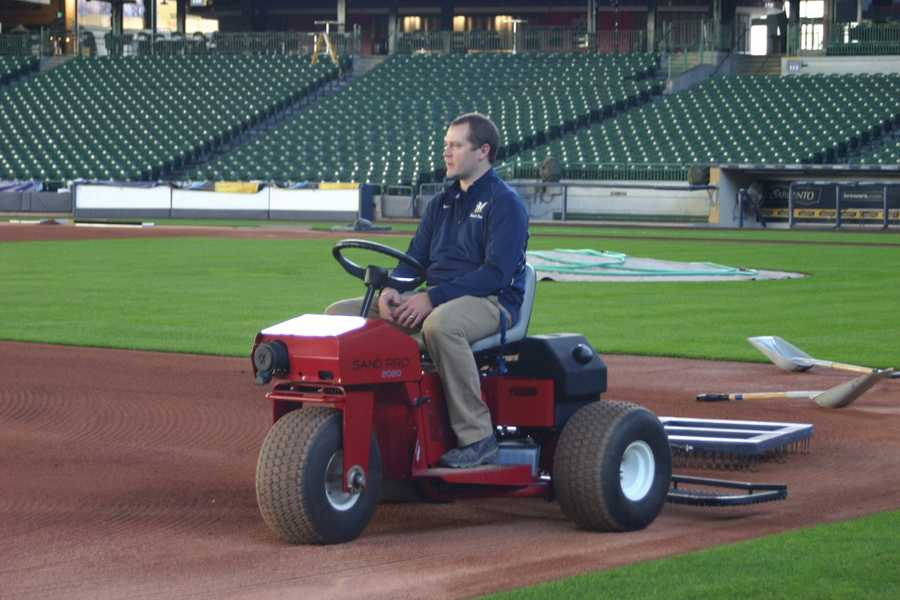 Director of Grounds, Justin Scott sitting on one of the grounds crew vehicles.
