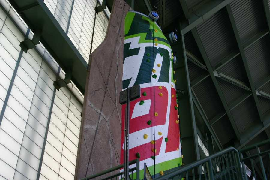 The rock wall is 25 feet high and shaped like a Mt. Dew can.
