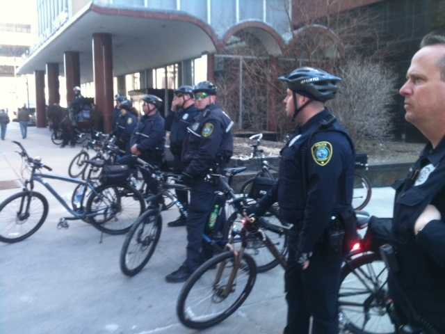 Milwaukee police line up outside City Hall to monitor the rally turned protest by Derek Williams' supporters.