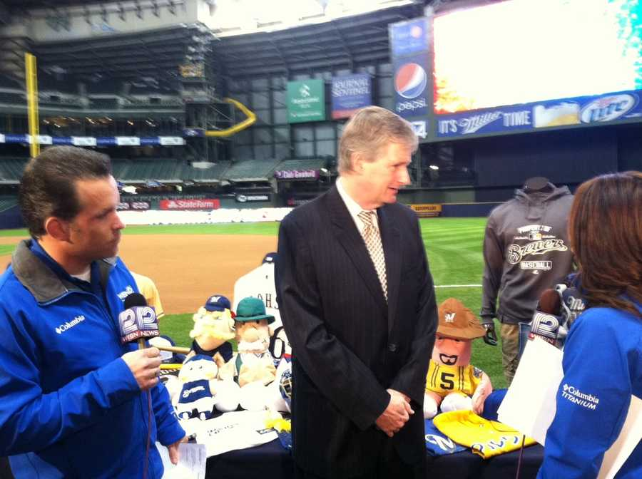 WISN 12 News' Craig McKee and Marianne Lyles with Brewers Vice President of Communications Tyler Barnes.