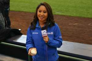 WISN 12 News' Marianne Lyles finds a baseball that came rolling into her live report.