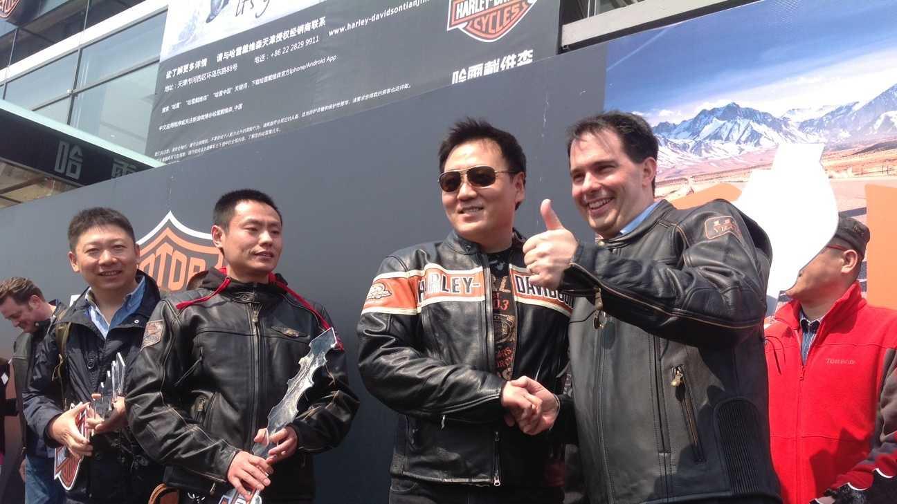 Gov. Scott Walker attends opening of Harley-Davidson dealership in China.