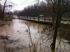 The Root River near 106th Street, going under - and possibly soon over - Cold Spring Road in Greenfield.