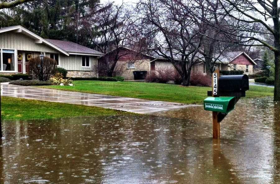 Greenfield neighborhood near 92nd Street and Forest Home on Root River Parkway is flooded.