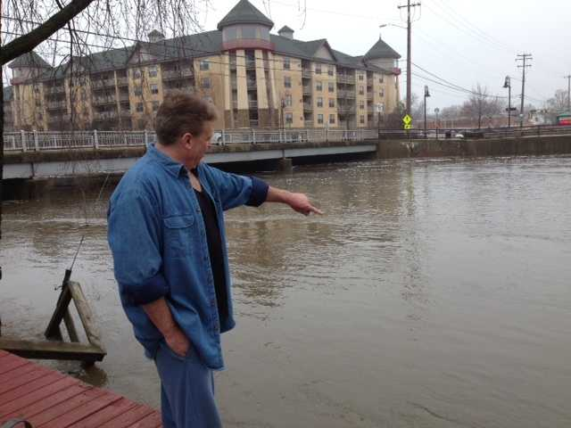Rich Cassidy points to where his 18' pier was washed away.