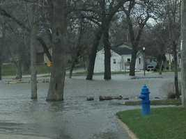 Residents along the Fox River in Racine County continue to watch the river rise on Friday.