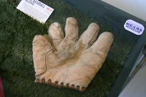 """1910-1920- Web baseball glove. The """"web"""" was a major innovation which today we may take for granted."""
