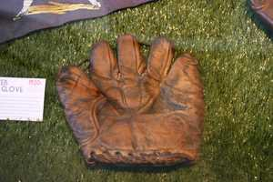 """1920's Tunnel web glove. This model was so revolutionary to have """"pocket"""" to catch the ball that the design remained available into the 1950's with only minor adjustments."""