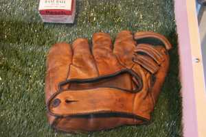 """1940's U.S. Army baseball glove. Many """"amateur"""" leagues started up overseas during the war."""