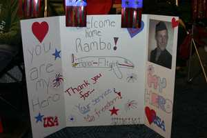 Often family and friends make signs and line-up at the airport hours before the expected arrival.