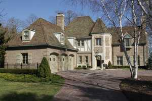 This Tudor/provincial home was built in 1930 and has a gorgeous view of Lake Michigan. With two private patios, it's made for outdoor fun. For more information about this property, click here.