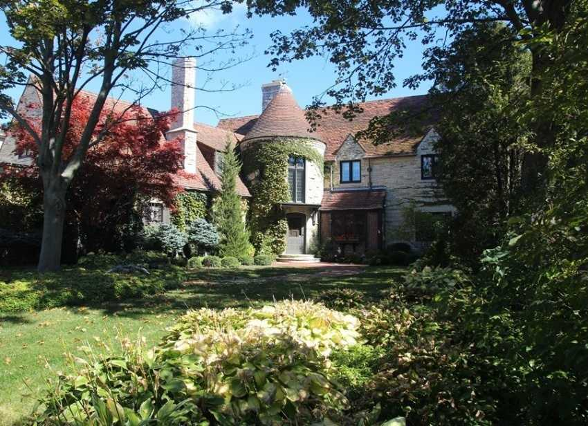 This Tudor revival home in Kenosha has six bedrooms and 4.5 baths and was built in 1930. Just the grounds that the house sits on are amazing. For more information about this property, click here.