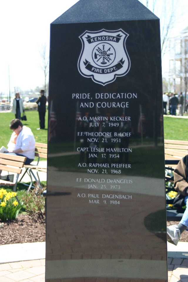 The monument is three sided: Kenosha Fire Department, Kenosha Police Department and Kenosha County Sheriff's Department.
