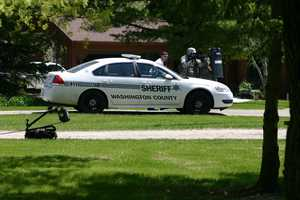 Other SWAT team members provided cover for the robot operator as he drove it to the house.