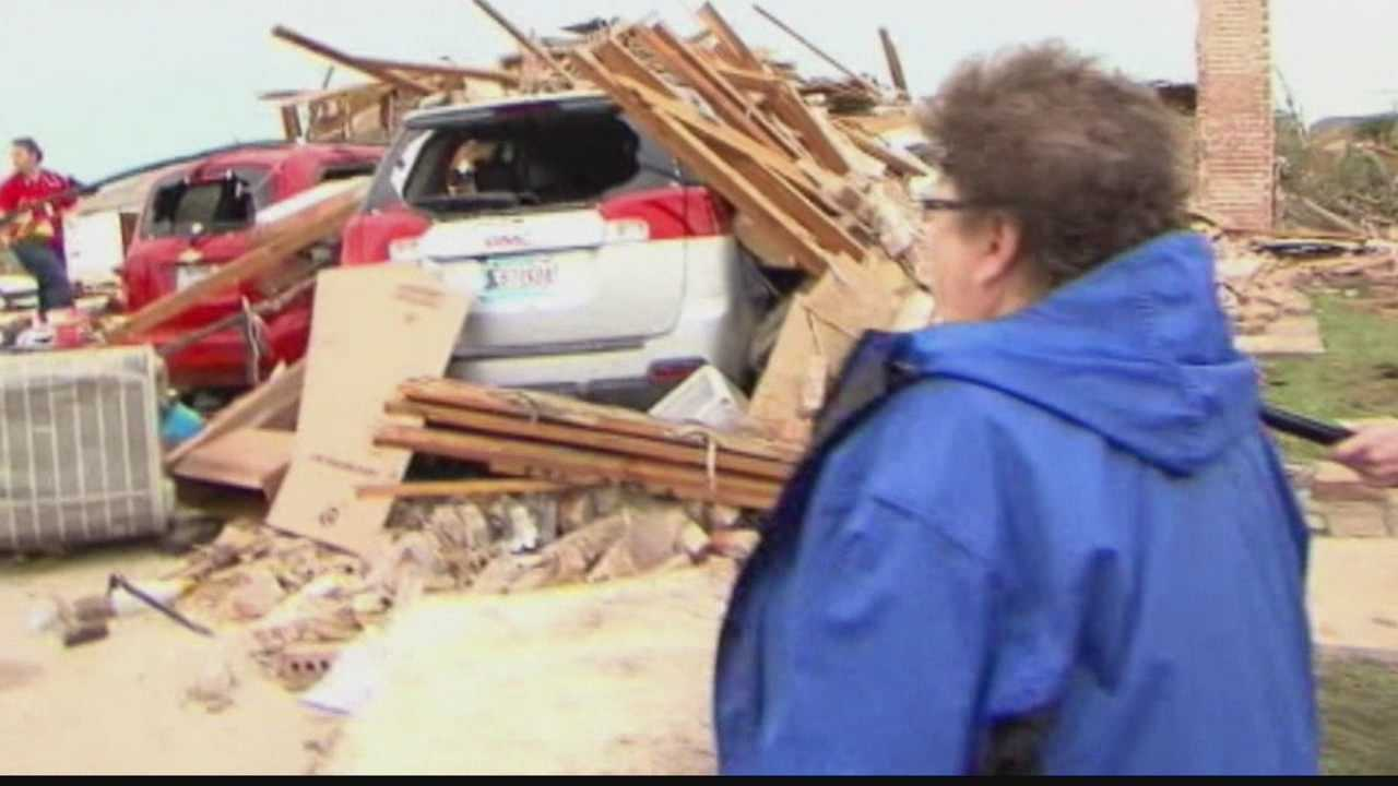 Residents are returning to the former sites of their homes in Moore, Oklahoma as rescue personnel continue the search for survivors of Monday's EF-5 tornado.